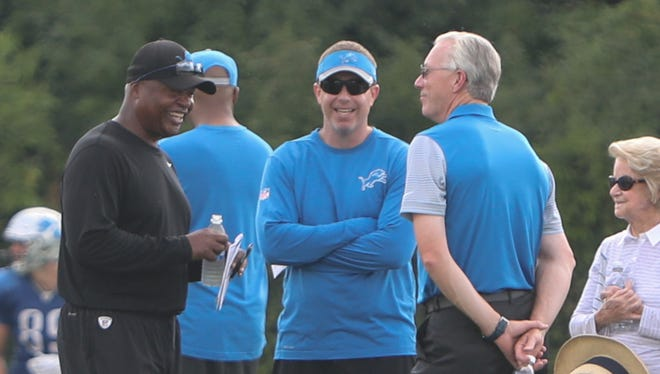 Detroit Lions coach Jim Caldwell talks with GM Bob Quinn and team president Rob Wood after training camp Monday, August 1, 2016.