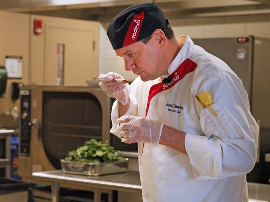 Executive chef Brad Dawson teaches a salad-making class in the new Innovation Kitchen at Marquette University.