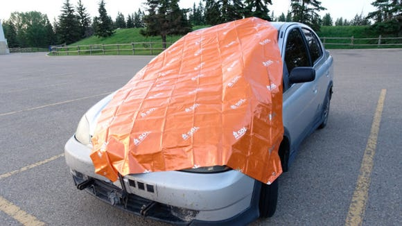 This large, lightweight tarp should have a. home in the trunk of everyone's vehicle.
