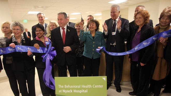 Rockland County Executive Ed Day, left, Congresswoman Nita Lowey, center, and CEO of Nyack Hospital David Freed, right, smile for photographers for a ribbon cutting ceremony to mark the opening of the new Behavioral Heath Center at Nyack Hospital on April 17, 2014.