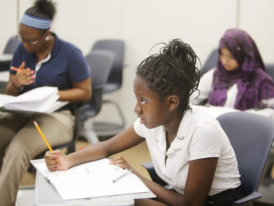 Kristeana Banks, 13, front, a freshman at Cass Tech, is in English class with other students including Taylor Saeton, 14 a freshman at Martin Luther King High School, and Sadia Begum, 15, a freshman at Cass Tech.