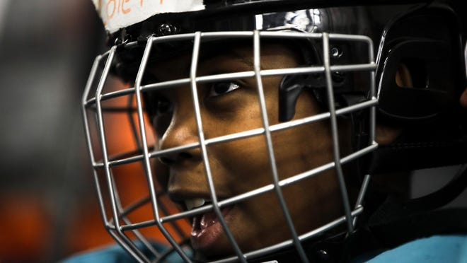In this Feb. 21, 2019 photo Malakye Johnson prepares for a Snider Hockey practice at the Scanlon Ice Rink in Philadelphia.
