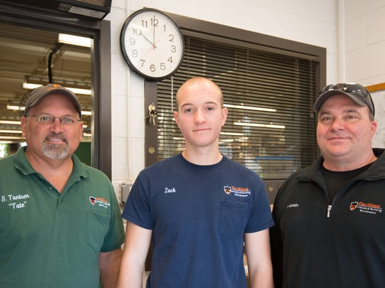 "Zack Scrape (center) with Princeton University  carpenter shop assistant supervisors Sterling ""Tate"" Tantum and James ""Jim"" Elberson."