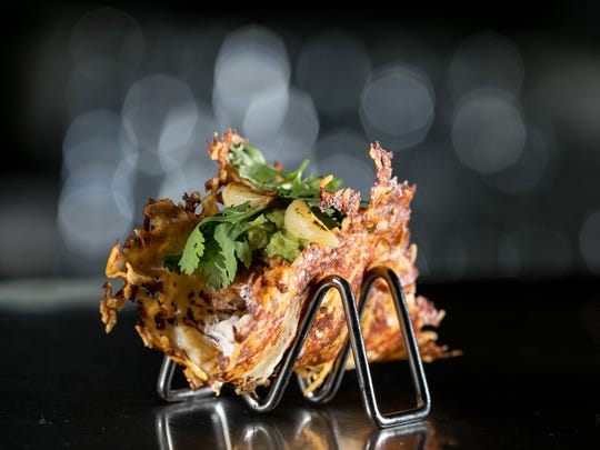 One the favorites at Yard House is the Vampire Taco, a cheese-crusted and grilled tortilla shell, filled with bacon chorizo, carnitas, chipotle, cilantro, cumin crema, guacamole and roasted garlic.