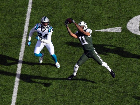 New York Jets wide receiver Robby Anderson (11) completes a pass in the first quarter. The Carolina Panthers at New York Jets on November 26, 2017 in East Rutherford, NJ.