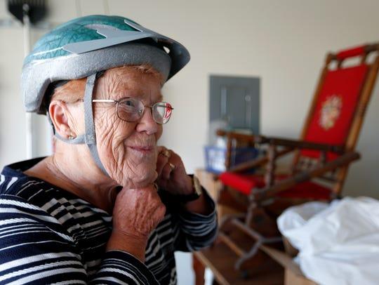 LaWanka Mallard, 74, puts on her helmet as she prepares