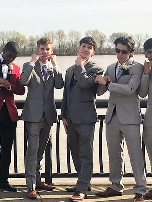 Harrison prom gents Alfonso Shaw, Steve Gansman, Luke Albright, Evan Lynch and Harry Rodriguez strike a fun pose before pairing up with their dates as they head out to the prom.