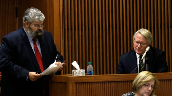 Prosecutor Matt Hart and witness William Brooke look