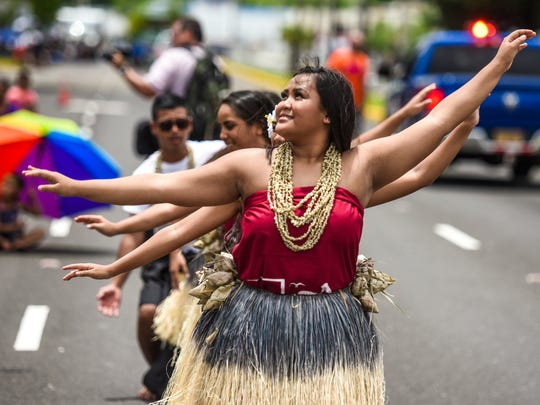 Ciena Manibusan and fellow I Mane'lu Cultural Arts Program dancers entertain grandstand dignitaries and other parade goers during the Liberation Day Parade in Hagåtna on Saturday, July 21, 2018.