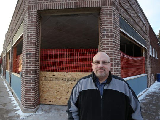 In this January photo, owner Chad Hoffer stands outside of what he hopes will be North Abbey Brewing Co. in Mosinee.
