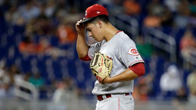 Cincinnati Reds starting pitcher Robert Stephenson adjusts his cap during the first inning of a baseball game against the Miami Marlins, Thursday, July 27, 2017, in Miami. (AP Photo/Lynne Sladky)