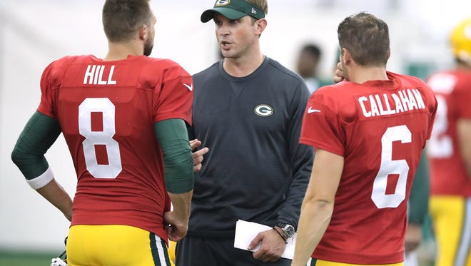 Packers assistant coach David Raih talks with quarterback Taysom Hill (8) and quarterback Joe Callahan (6) during training camp Thursday, Aug. 3, 2017 in the Don Hutson Center.