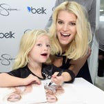 DALLAS, TX - NOVEMBER 22:Jessica Simpson, wearing Jessica Simpson Collection,(right) with Maxwell Drew Johnson, wearing Jessica Simpson Girls attend Jessica Simpson and Ashlee Simpson Ross come home for the holidays in support of the Jessica Simpson Collection and the launch of Jessica Simpson Home at Belk Galleria Dallas on November 22, 2014 in Dallas, Texas.  (Photo by Jamie McCarthy/Getty Images for Jessica Simpson Collection) ORG XMIT: 524911857 ORIG FILE ID: 459423044