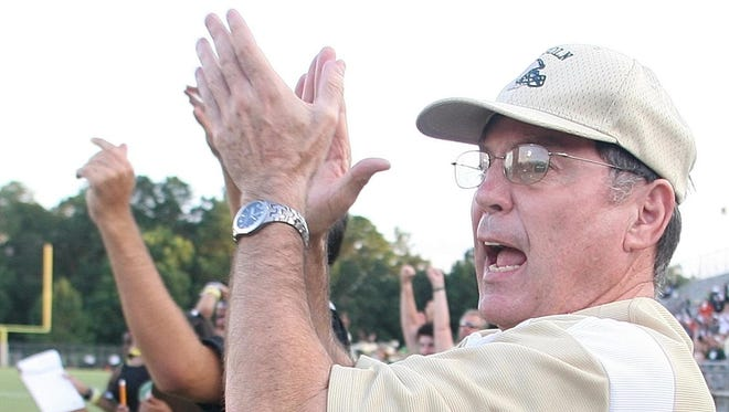 Former Lincoln head coach David Wilson claps as he sees Buck Allen catch a touchdown pass in a 2007 game. Wilson, who stopped coaching in 2007, retired from teaching this year.