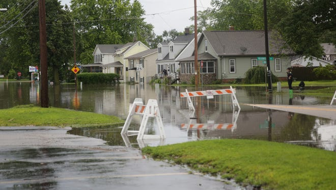Flooding in last week's torrential rains closed Pine St., north of E. Market St., in Burlington on July 12.
