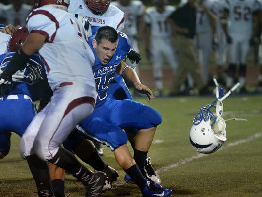Fillmore's Marshall Martinez loses his helmet during