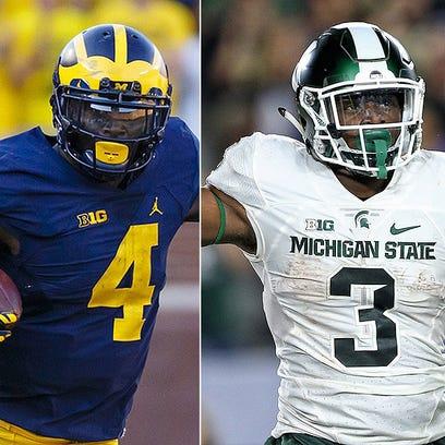 Michigan's De'Veon Smith and Michigan State's L.J.