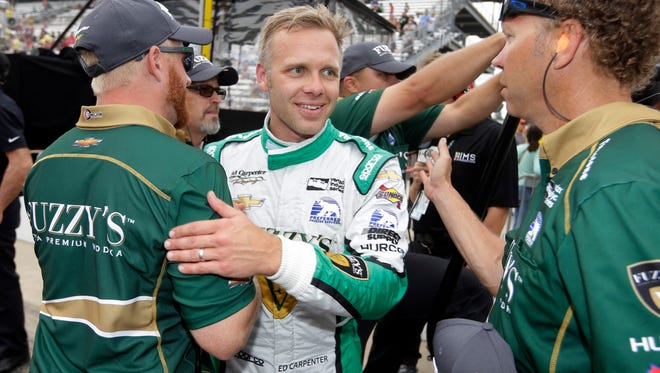 Ed Carpenter celebrates with his crew after he qualified with the fastest time during qualifications for the Indianapolis 500 IndyCar auto race at Indianapolis Motor Speedway, Saturday, May 20, 2017 in Indianapolis. (AP Photo/Michael Conroy)
