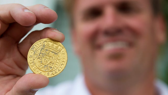 A tricentennial Royal, worth an estimated $500,000, was among the 51 coins found by treasure hunters aboard the Aarrr Booty near Fort Pierce. Brent Brisben, the owner of 1715 Fleet - Queens Jewels, displayed the collection during a 2015 press conference in Sebastian.
