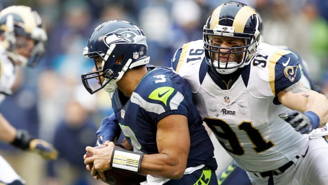 Have Chris Long (91) and the Rams done enough to catch up to Russell Wilson's champion Seahawks?