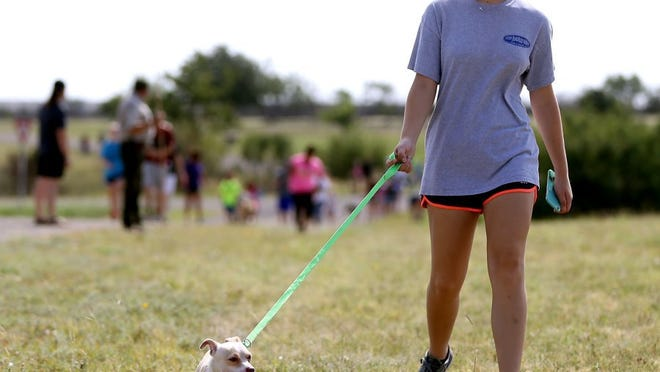 Adam Sauceda/Standard-Times Residents walk dogs at San Angelo State Park during the Concho Valley PAWS Hike with a Homeless Dog event on Saturday.