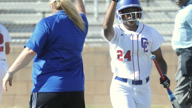 Joey D. Richards/Reporter-News Cooper's Symone Gary (24) gets a high-five from coach Stacey Herring after on Kaitlyn Murphy's two-out single in the fifth, tying the game 2-2 against Plainview. The Lady Cougars won the game 3-2 Tuesday at Cougar Diamond.
