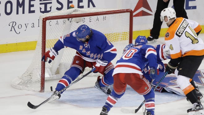Rangers' Kevin Klein (8) watches the puck shot by Flyers' Jakub Voracek get past him for a goal during the third period of a game Wednesday, Jan. 25, 2017, in New York. The Flyers won 2-0.