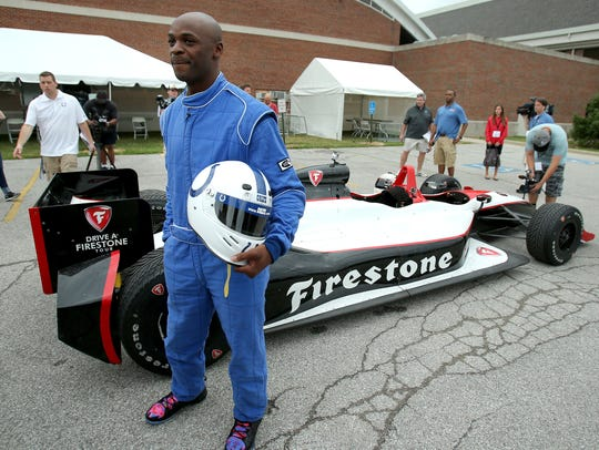 Colts wide receiver Reggie Wayne arrives in a two-seater