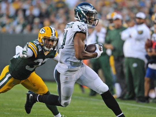 Green Bay Packers defender Micah Hyde (33) tries to