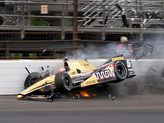 Schmidt Peterson Motorsports driver James Hinchcliffe (5) hits the wall coming out of turn 3 during practice for the 99th Indianapolis 500 May 18, 2015 at the Indianapolis Motor Speedway.