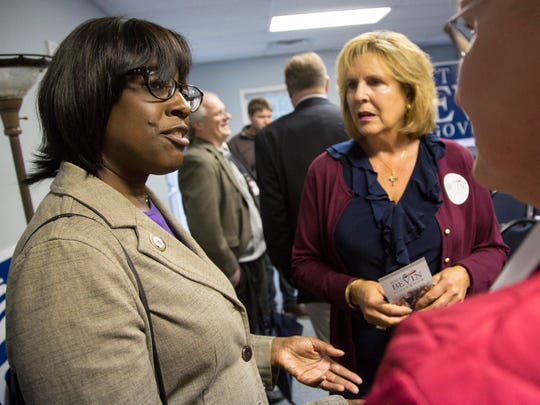 Lt. Gov. candidate Jenean Hampton, center, talks faith and politics with Aprile Hunt, center, of Heartland Apostolic Prayer Network, and Jo McCormick before U.S. Sen. Rand Paul and GOP candidate for governor Matt Bevin take the stage during a rally at Kentucky State University's Baptist Campus Ministry in Frankfort, Ky. October 3, 2015.