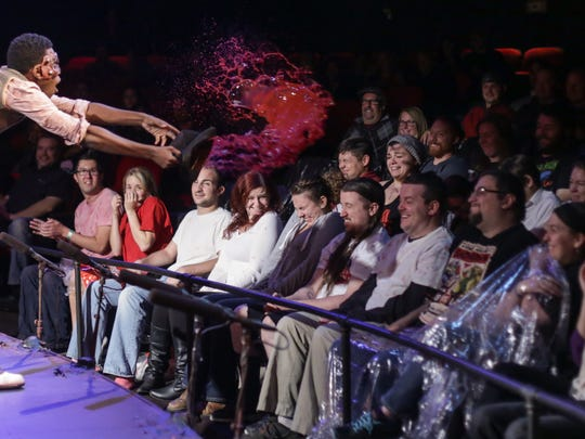 Stage blood is thrown at the crowd sitting in the splash