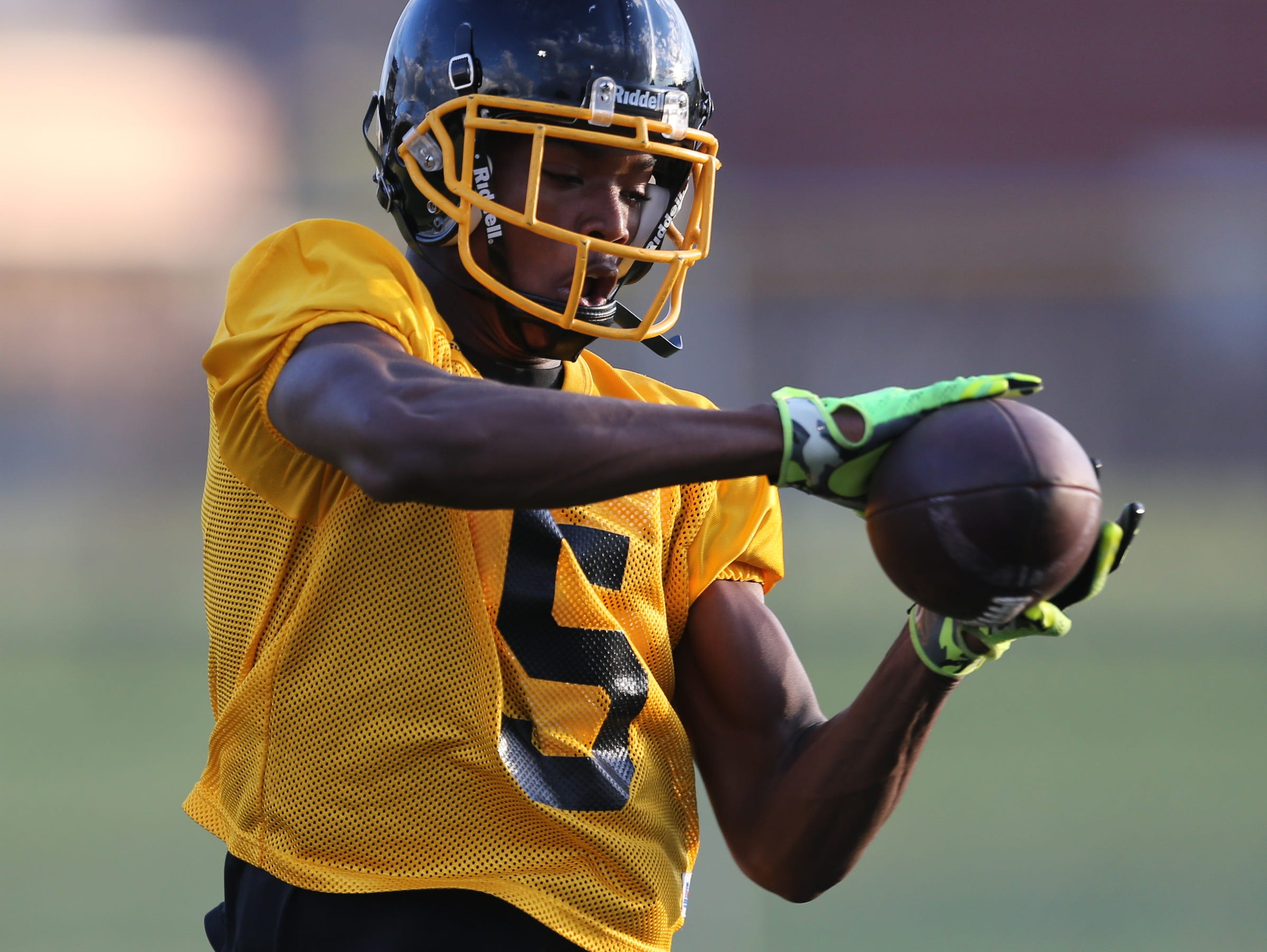 Detroit King wide receiver Donnie Corley goes through drills on Aug.11, 2015.