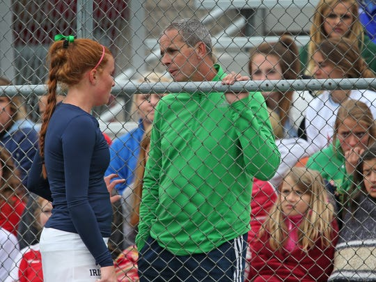 Cathedral coach Mark Noe, right, talks with Maeve Koscielski between sets during last year's sectional action.