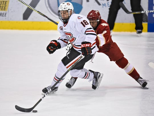 St. Cloud State's Judd Peterson gets past Dylan Gambrell