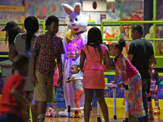 The Easter Bunny, Tashawn Carter, greets skaters during
