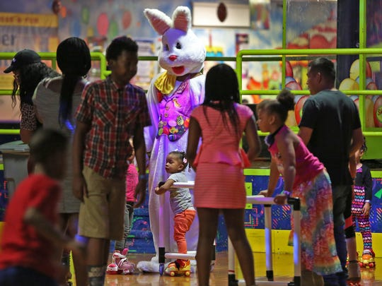 "The Easter Bunny, Tashawn Carter, greets skaters during Skateland's ""Biggest Skate Party of the Year,"" Sunday, April 16, 2017.  With extended hours and two hours free admission, skaters new to the activity and seasoned, enjoyed the fun."