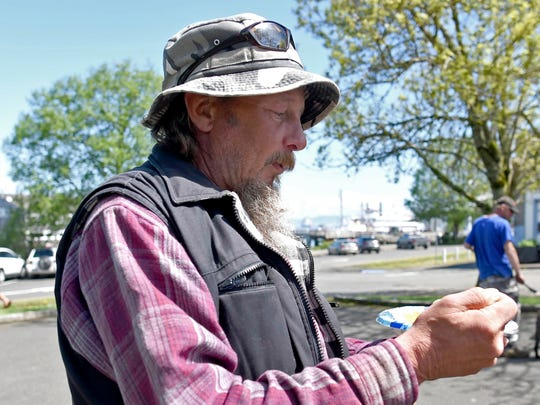 In this Wednesday May 3, 2017 photo, a man who wished to be identified only as Ted stopped by People's Park in Astoria, Ore.,  to take advantage of some of the services offered by the Riverfolk non-profit group which also tries to help the homeless replace lost or stolen personal documents.