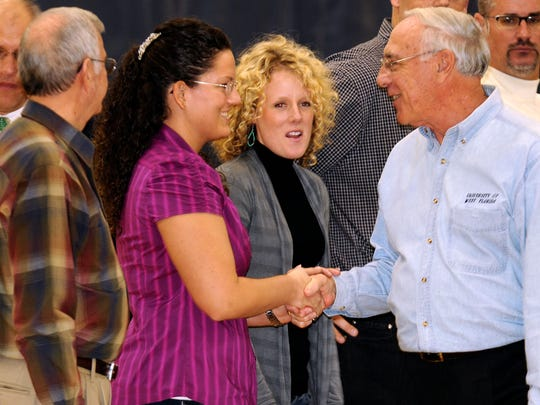 Marvin Beck, far left, was part of a 2010 ceremony honoring him. along with  Krissy Styrna-Warriner (shaking hands with former AD Richard Berg) during induction recognition into UWF Athletics Hall of Fame..