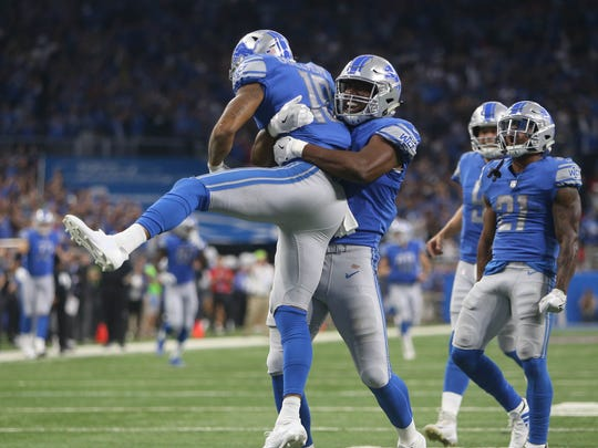 Kenny Golladay, left, celebrates his 45-yard touchdown against the Cardinals with Darren Fells late in the fourth quarter of the Lions' 35-23 win in the opener Sunday, Sept. 10, 2017 at Ford Field. .