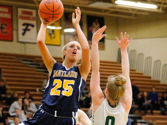 Hartland's Whitney Sollom puts up a shot over Howell's