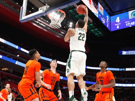 Miles Bridges scores against Bucknell during the first half Friday.