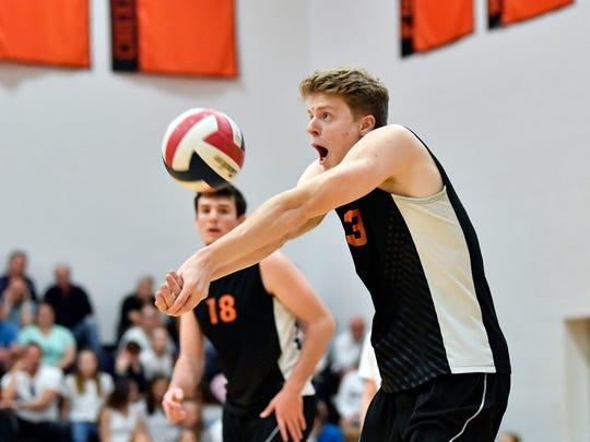 Central York's Kyle Mehl bumps the ball against Northeastern in the first set of a YAIAA boys' volleyball match in 2018 at Northeastern. Northeastern defeated Central, 3-2, to win the regular-season YAIAA title.
