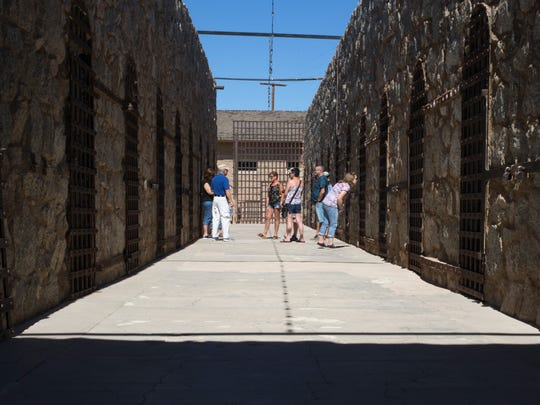 The prison opened in 1876 and operated until 1909. A group tours the cell block at the Yuma Territorial Prison State Historic Park, 1 Prison Hill Road, Yuma, Ariz., Oct. 14, 2015.