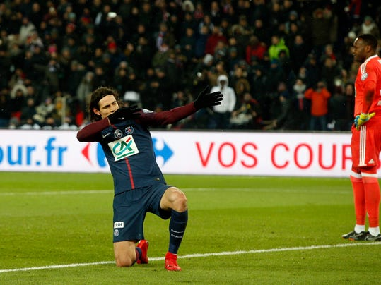 PSG's Edinson Cavani celebrates after scoring his side's third goal during the French Cup soccer match between Paris Saint-Germain and Marseille at the Parc des Princes Stadium, in Paris, France, Wednesday, Feb. 28, 2018. (AP Photo/Thibault Camus)