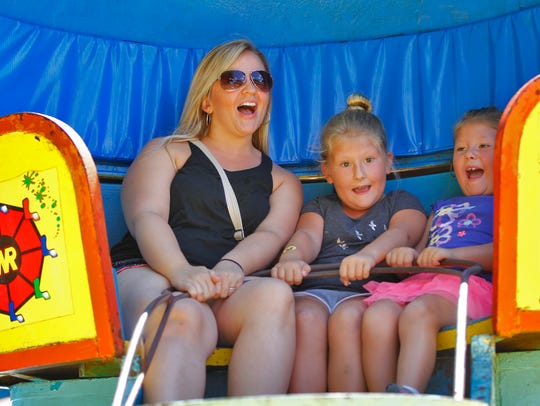 Stephanie Wanda, of Kirkwood, rides the Tilt-A-Whirl