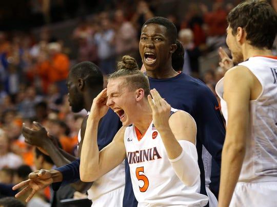 Virginia guard Kyle Guy (5) celebrates o the bench