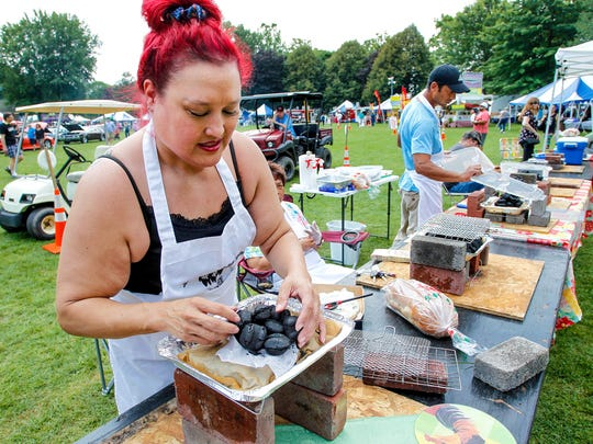 Katharine Madden of Endicott sets-up her cooking station for the spiedie cooking contest at the 33rd Spiedie Fest & Balloon Rally at Otsiningo Park, Binghamton. Sunday, August 6, 2017.   Thomas La Barbera / Correspondent