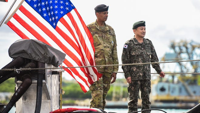 Gen. Vincent K. Brooks, left, Commander of United Nations Command, Combined Forces Command and U.S. Forces Korea, is seen beside Gen. Sun Jin Lee, Republic of Korea Joint Chiefs of Staff chairman, on the hull of the U.S.S. Pennsylvania during a visit to the Naval Base Guam in Sumay on Tuesday, Nov. 1, 2016.