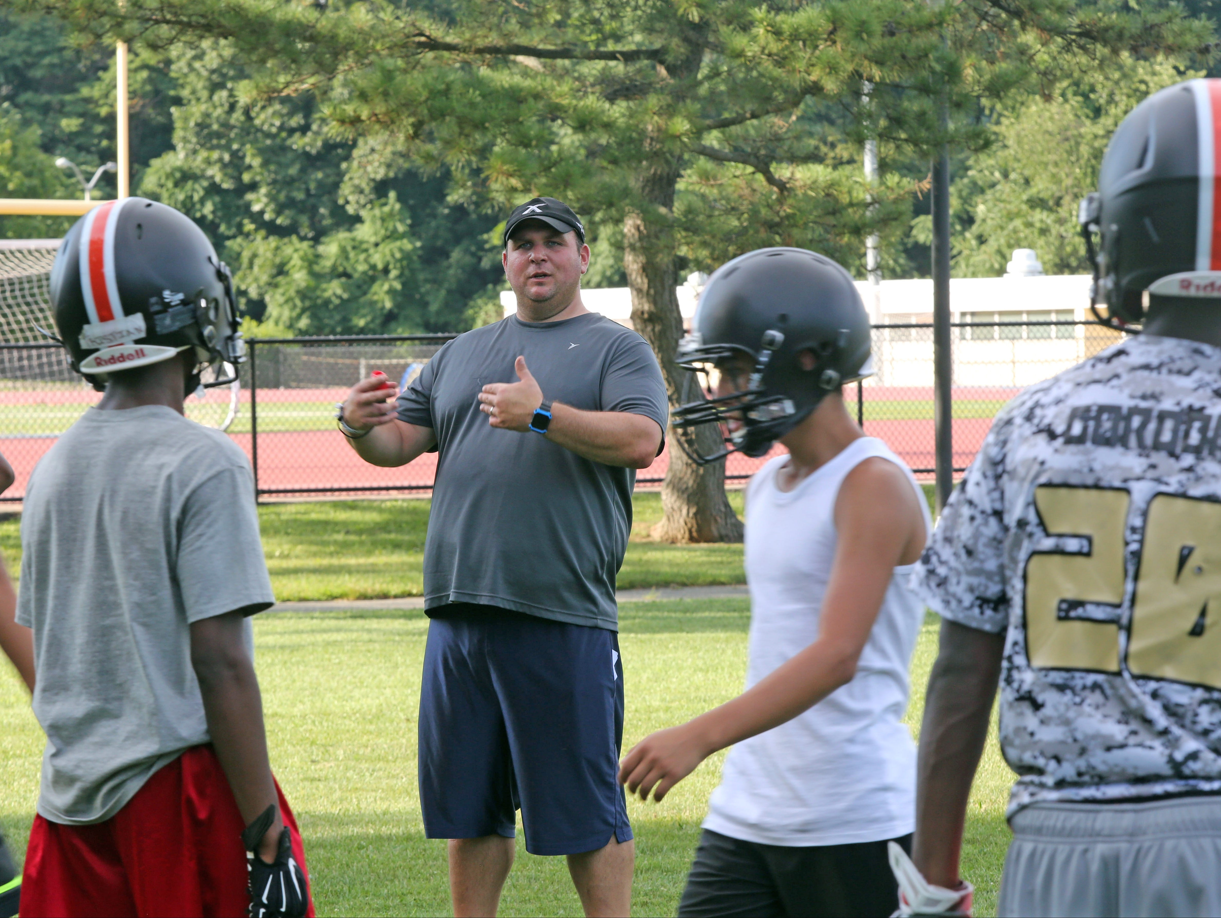 New White Plains coach Mike Lindberg, a former star lineman at Clarkstown South who had been a longtime assistant at Arlington leads football practice at White Plains High School on Monday, Aug. 14, 2016.